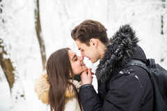Happy young couple having fun in the winter park Stock Photo