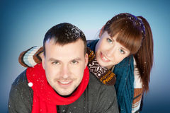 Happy young couple having fun at winter time Royalty Free Stock Image
