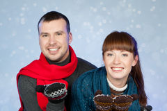 Happy young couple having fun at winter time Stock Photos
