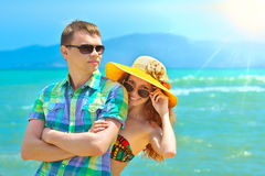 Happy young couple having a rest on a beach. Royalty Free Stock Photos