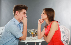 Happy young couple having romantic dinner Stock Photos