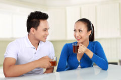 Happy young couple having tea Stock Images