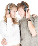 Happy young couple in headphones Stock Photos