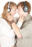 Happy young couple in headphones Stock Image