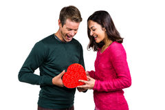 Happy young couple with heart shape gift Royalty Free Stock Image