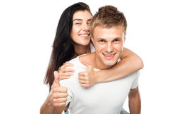 Happy young couple with his thump up Stock Photo