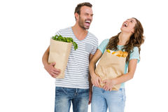 Happy young couple holding bag of vegetables Royalty Free Stock Image