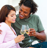 Happy young couple holding champagne glasses Royalty Free Stock Photos