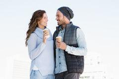Happy young couple holding disposable coffee cup Stock Photo