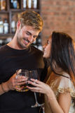 Happy young couple holding drink glasses Stock Photos