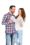 Happy young couple holding fanned out currency notes Royalty Free Stock Image