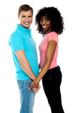 Happy young couple holding hands Royalty Free Stock Images
