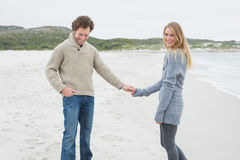 Happy young couple holding hands at beach Royalty Free Stock Images