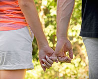 Happy young couple holding hands Stock Photography