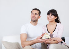 Happy young couple holding a house model Royalty Free Stock Photo