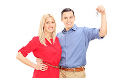 Happy young couple holding keys Stock Photo