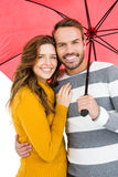 Happy young couple holding pink umbrella Stock Photos