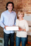 Happy young couple holding pizza boxes Royalty Free Stock Photo