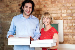 Happy young couple holding pizza boxes Stock Photo