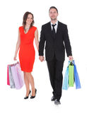 Happy Young Couple Holding Shopping Bags Stock Images