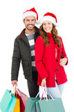Happy young couple holding shopping bags. On white background Stock Image