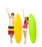 Happy young couple holding surfboard Royalty Free Stock Photography