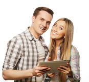 Happy young couple holding tablet pc computer Royalty Free Stock Photos