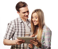 Happy young couple holding tablet pc computer Stock Image