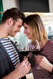 Happy young couple holding wineglass royalty free stock photography