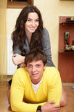 Happy young couple at home Stock Photography