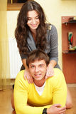 Happy young couple at home Royalty Free Stock Photos