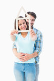 Happy young couple with house shape Stock Image