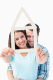Happy young couple with house shape Stock Photography