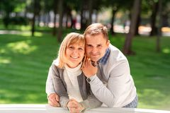 Happy Young Couple Hugging And Laughing Together In The Park Royalty Free Stock Photography