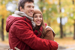 Happy young couple hugging in autumn park Stock Photo