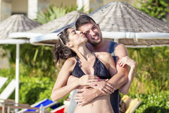 Happy young couple hugging  on the beach Stock Image