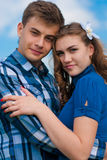 Happy Young couple hugging & blue sky Royalty Free Stock Photo