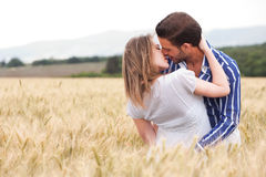 Happy young Couple hugging and kissing eachother Stock Images