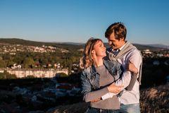 Happy young couple hugging and laughing outdoors. royalty free stock image