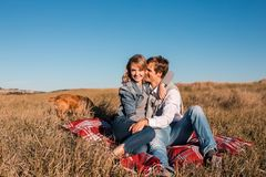 Happy young couple hugging and laughing outdoors. royalty free stock photography