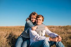 Happy young couple hugging and laughing outdoors. royalty free stock photo