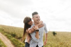 Happy young couple hugging and laughing outdoors. Love and tenderness. Lifestyle concept royalty free stock photos