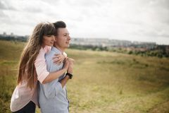 Happy young couple hugging and laughing outdoors. Love and tenderness. Lifestyle concept stock image