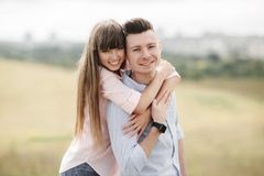 Happy young couple hugging and laughing outdoors. Love and tenderness. Lifestyle concept stock photos