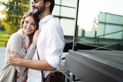 Happy young couple hugging and laughing outside. Happy young couple hugging and laughing outdoors stock images