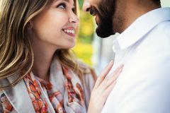 Happy young couple hugging and laughing outside. Happy young couple hugging and laughing outdoors royalty free stock photography
