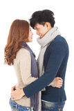 Happy young couple hugging and looking Royalty Free Stock Image