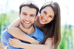 Happy young couple. Hugging outdoors stock photo