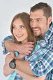 Happy young couple hugging royalty free stock images