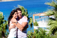 Happy young couple hugging on a sea background Stock Photography